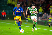 Nordi Mukiele (#22) of RB Leipzig and Kieran Tierney (#63) of Celtic FC chase the ball during the Europa League group stage match between Celtic and RP Leipzig at Celtic Park, Glasgow, Scotland on 8 November 2018.