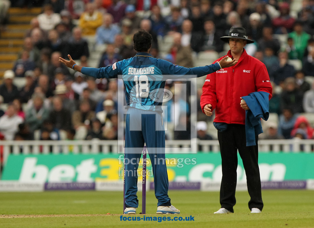 Sachithra Senanayake (centre) of Sri Lanka runs out Jos Buttler of England during the Royal London One Day Series match at Edgbaston, Birmingham<br /> Picture by Tom Smith/Focus Images Ltd 07545141164<br /> 03/06/2014
