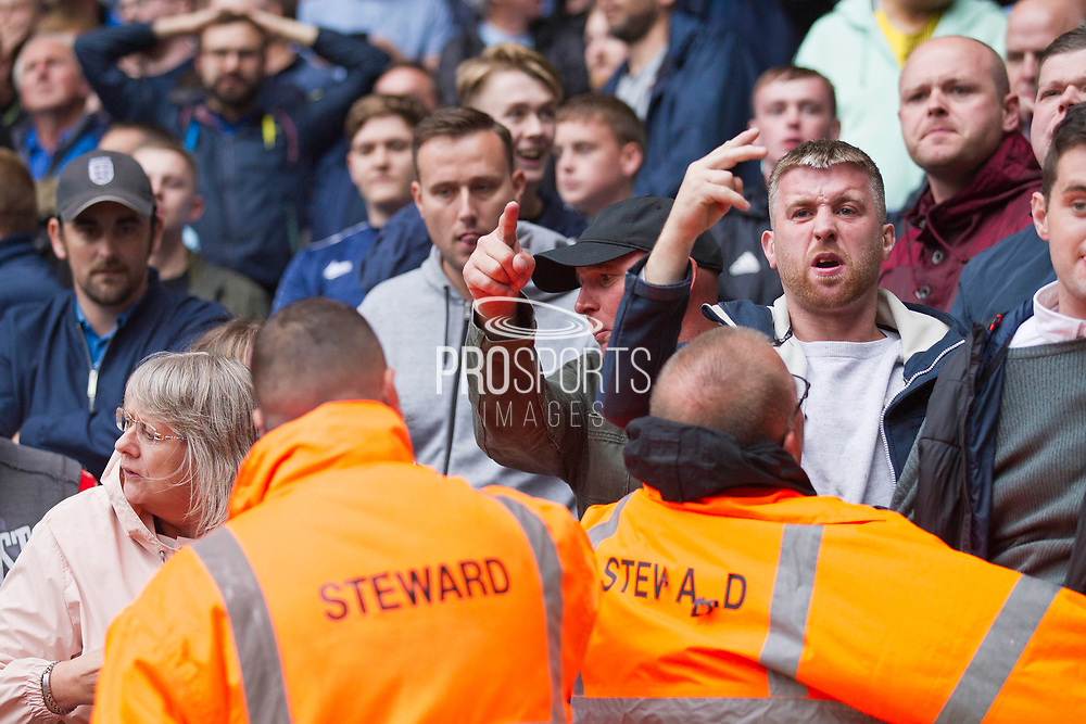 Protesters in the crowd during the EFL Sky Bet League 1 match between Bolton Wanderers and Coventry City at the University of  Bolton Stadium, Bolton, England on 10 August 2019.