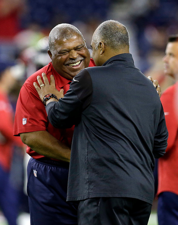 Houston Texans defensive coordinator Romeo Crennel, left, talks with Cincinnati Bengals coach Marvin Lewis before an NFL football game Saturday, Dec. 24, 2016, in Houston. (AP Photo/Sam Craft)