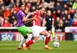 George Moncur of Barnsley takes on Korey Smith of Bristol City - Mandatory by-line: Robbie Stephenson/JMP - 30/03/2018 - FOOTBALL - Oakwell Stadium - Barnsley, England - Barnsley v Bristol City - Sky Bet Championship