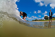 Lauren Hahn Photographing Darryl Torckler at Orewa beach, with Ryan Boyd the client watching the shoot. To see more of Lauren's work;<br /> http://www.laurenhahnphoto.com<br /> Photo taken by Darryl Torckler with a 10.5 fisheye lens on a Nikon D2x. To see Darryl's underwater photography work;  http://www.darryltorckler.co.nz