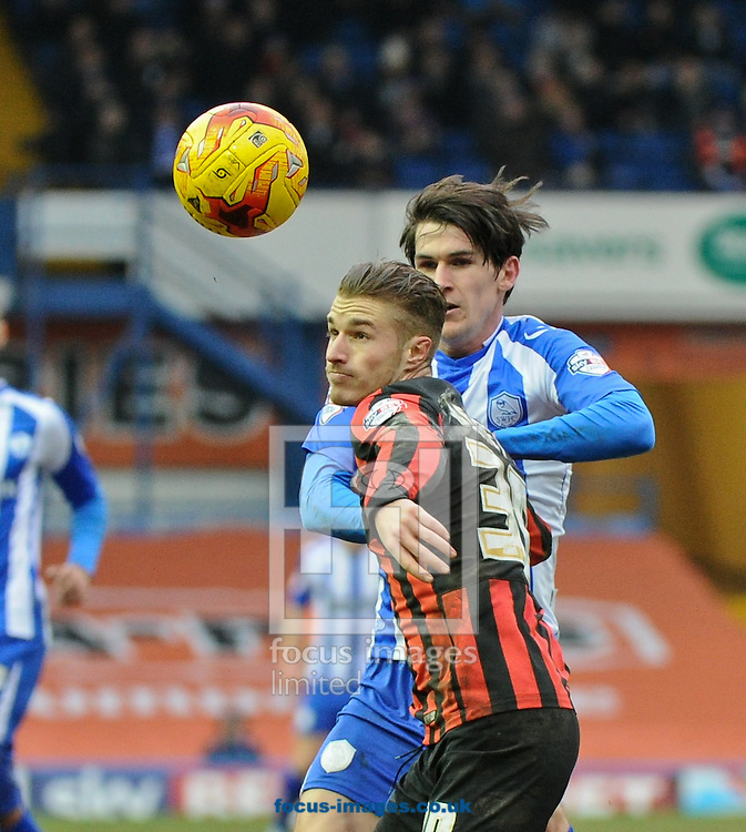 Kieran Lee of Sheffield Wednesday and Joe Bennett of Brighton and Hove Albion during the Sky Bet Championship match at Hillsborough, Sheffield<br /> Picture by Richard Land/Focus Images Ltd +44 7713 507003<br /> 14/02/2015
