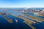 Nederland, Noord-Holland, IJmuiden, 11-12-2013; IJmuiden, met sluizencomplex: Middensluis, Noordersluis en de Spuisluis. Noordzeekanaal en Tata Steel (voorheen Corus, Hoogovens). Noordzee in de achtergrond.<br /> Entrance  Noorzee-channel with locks and Tata Steel in the background.<br /> luchtfoto (toeslag op standaard tarieven);<br /> aerial photo (additional fee required);<br /> copyright foto/photo Siebe Swart.