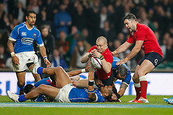 England Full Back Mike Brown scores a try as Samoa Inside Centre Johnny Leota attempts to hold him up - Photo mandatory by-line: Rogan Thomson/JMP - 07966 386802 - 22/11/2014 - SPORT - RUGBY UNION - London, England - Twickenham Stadium - England v Samoa - QBE Autumn Internationals.