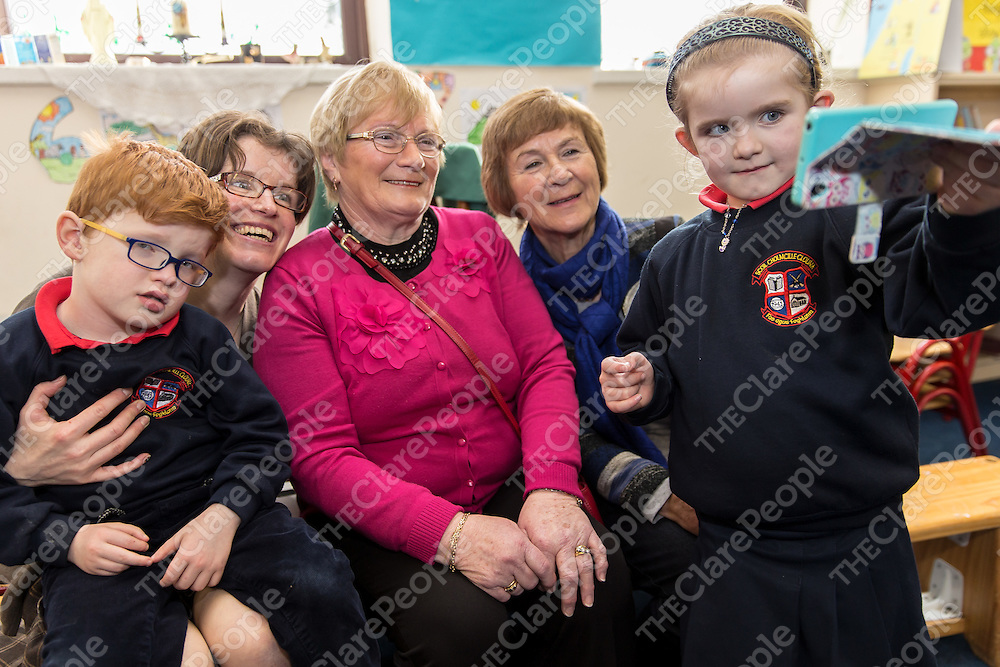 Junior Infant Caoimhe Moroney taking a selfie with her brother Darragh, mother Aisling, and grandmothers Geraldine Greene and Margaret Moroney