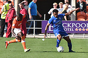 Oldham Athletic Forward, Darius Osei (18) and Blackpool Midfielder, Bright Osayi-Samuel (21) during the EFL Sky Bet League 1 match between Blackpool and Oldham Athletic at Bloomfield Road, Blackpool, England on 26 August 2017. Photo by Mark Pollitt.