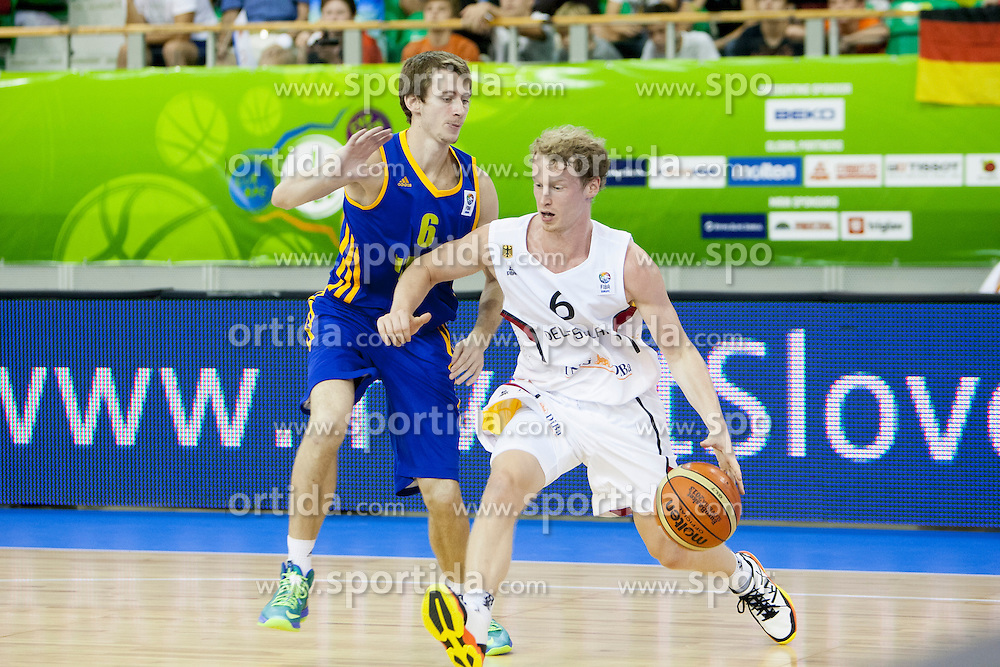 Olexandr Mishula #6 of Ukraine and Per Gunther #6 of Germany during basketball match between National teams of Germany and Ukraine at Day 3 of Eurobasket 2013 on September 6, 2013 in Tivoli Hall, Ljubljana, Slovenia. (Photo By Urban Urbanc / Sportida )