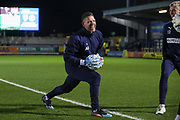 AFC Wimbledon goalkeeping coach Ashley Bayes warming up during the EFL Sky Bet League 1 match between AFC Wimbledon and Burton Albion at the Cherry Red Records Stadium, Kingston, England on 28 January 2020.