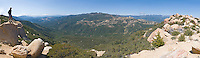 Panorama of a hiker overlooking the Matilija Wilderness from Divide Peak in Los Padres National Forest near Ojai, California.