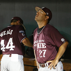 Jun 25, 2013; Omaha, NE, USA; Mississippi State Bulldogs assistant coach Nick Mingione (27) reacts after game 2 of the College World Series finals against the UCLA Bruins at TD Ameritrade Park. UCLA defeated Mississippi State 8-0. Mandatory Credit: Derick E. Hingle-USA TODAY Sports