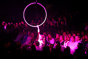 Accountancy employees watch motivational circus acrobats at their corporate rally day, held for 3,000 UK staff at Excel