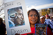 19 JANUARY 2009 -- PHOENIX, AZ: A woman marches through Phoenix in honor slain civil rights leader Dr. Martin Luther King Jr and incoming President Barack Obama. About 500 people marched three miles through Phoenix, Monday Jan. 19, in memory of Dr. Martin Luther King Jr. This year the march also marked Jan 20 inauguration of Barack Obama as the US President.   PHOTO BY JACK KURTZ