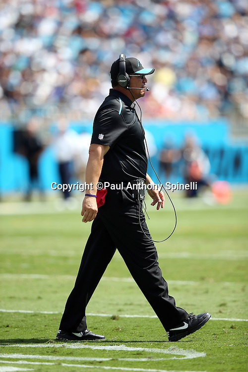 Carolina Panthers head coach Ron Rivera talks on his headsets near the sideline during the 2015 NFL week 2 regular season football game against the Houston Texans on Sunday, Sept. 20, 2015 in Charlotte, N.C. The Panthers won the game 24-17. (©Paul Anthony Spinelli)