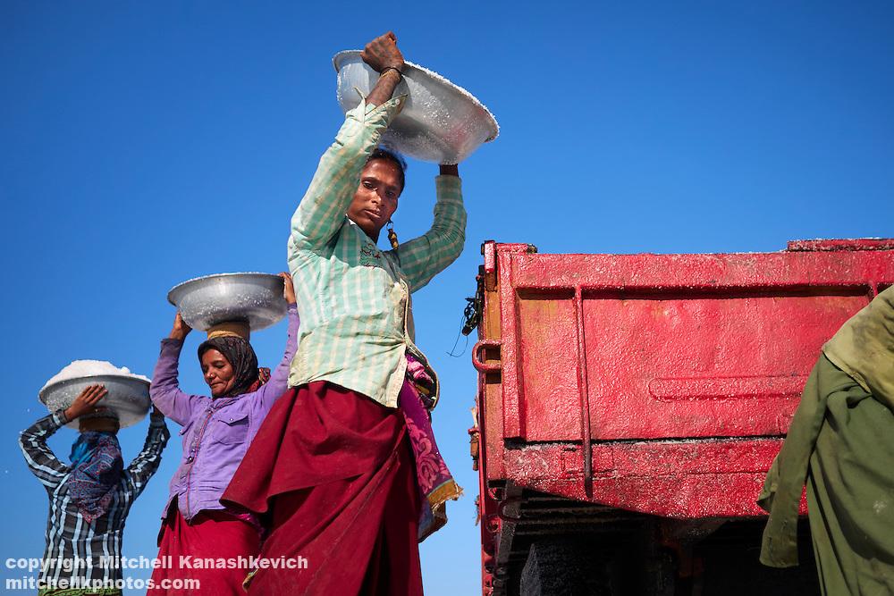 Salt workers in salt pans around Dwarka, Gujarat, India. Salt workers in salt pans around Dwarka, Gujarat, India.
