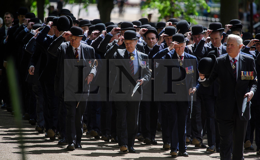 © London News Pictures. 14/05/2017. London, UK. Former cavalrymen 'doff' their hats during the parade, as thousands of serving and former Cavalrymen, many wearing bowler hats and carrying closed umbrellas, take part in Combined Cavalry Old Comrades Association Annual Parade in Hyde Park, London. A service of remembrance is held to honour Cavalry and other troops who have fallen in the service of their country since the first world war. Photo credit: Ben Cawthra/LNP