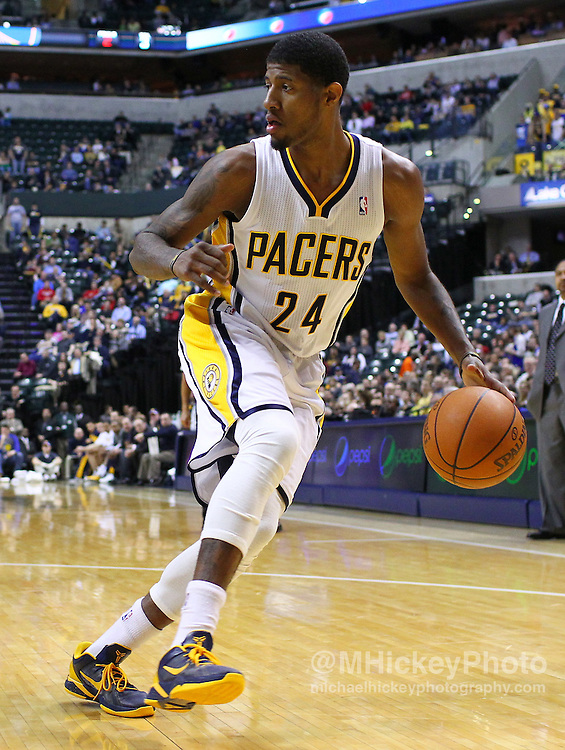 Feb. 28, 2012; Indianapolis, IN, USA; Indiana Pacers shooting guard Paul George (24) dribbles the ball along the baseline against the Golden State Warriors at Bankers Life Fieldhouse. Indiana defeated Golden State 102-78. Mandatory credit: Michael Hickey-US PRESSWIRE