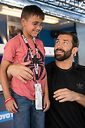 HOUSTON, TX - OCTOBER 3:  Luke Rockhold poses for a photo with a fan during the UFC 192 fan village at the Toyota Center on October 3, 2015 in Houston, Texas. (Photo by Cooper Neill/Zuffa LLC/Zuffa LLC via Getty Images) *** Local Caption *** Luke Rockhold
