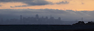 Panoramic of Sunset Fog Rolling In Over Downtown San Francisco Skyline, California