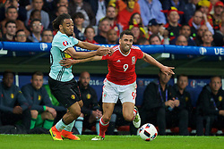LILLE, FRANCE - Friday, July 1, 2016: Wales' Hal Robson-Kanu in action against Belgium's Jason Denayer during the UEFA Euro 2016 Championship Quarter-Final match at the Stade Pierre Mauroy. (Pic by David Rawcliffe/Propaganda)