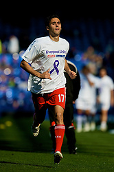 "LIVERPOOL, ENGLAND - Saturday, September 27, 2008: Liverpool's Alvaro Arbeloa warms up before the 208th Merseyside Derby match against Everton at Goodison Park. He is wearing a t-shirt to support the ""Liverpool Unites"" charity, created in the memory of Rhys Jones, the young Everton fan who was shot dead in Croxteth last year. (Photo by David Rawcliffe/Propaganda)"