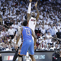 21 June 2012: Miami Heat small forward LeBron James (6) takes a three points jumpshot over Oklahoma City Thunder guard James Harden (13) during the Miami Heat 121-106 victory over the Oklahoma City Thunder, in Game 5 of the 2012 NBA Finals, at the AmericanAirlinesArena, Miami, Florida, USA. The Miami Heat wins the series 4-1.