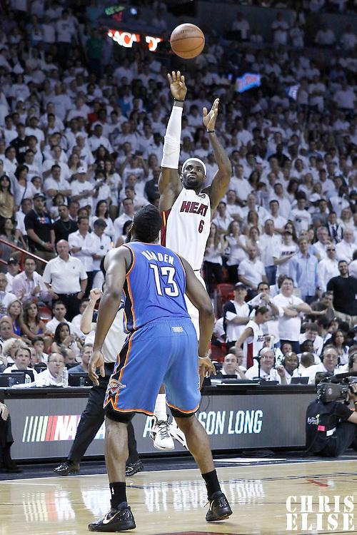 21 June 2012: Miami Heat small forward LeBron James (6) takes a three points jumpshot over Oklahoma City Thunder guard James Harden (13) during the Miami Heat 121-106 victory over the Oklahoma City Thunder, in Game 5 of the 2012 NBA Finals, at the AmericanAirlinesArena, Miami, Florida, USA. The Miami Heat wins the series 4-1.