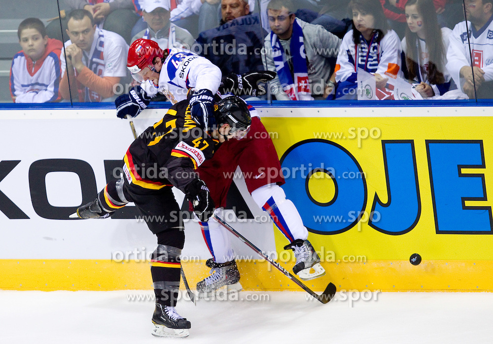 Christoph Ullmann of Germany vs Dmitri Kulikov  of Russia during ice-hockey match between Germany and Russia of Group A of IIHF 2011 World Championship Slovakia, on April 29, 2011 in Orange Arena, Bratislava, Slovakia. (Photo By Vid Ponikvar / Sportida.com)