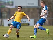 FODBOLD: Frank Holm (Ølstykke FC) presses af Mathias Olesen (Humlebæk) under kampen i Serie 2 mellem Ølstykke FC og Humlebæk Boldklub den 6. april 2019 på Ølstykke Stadion. Foto: Claus Birch.