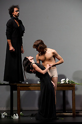 "© Copyright licensed to London News Pictures. 26/10/2010. Jorge Puerta Armenta (as Thoas, standing), Ruth Amarante (as Iphigenie) and Pablo Aran Gimeno (as Orest) in ""Iphigenie auf Tauris"", Tanztheater Wuppertal Pina Bausch, Sadler's Wells. A rare performance of Gluck's masterpiece."