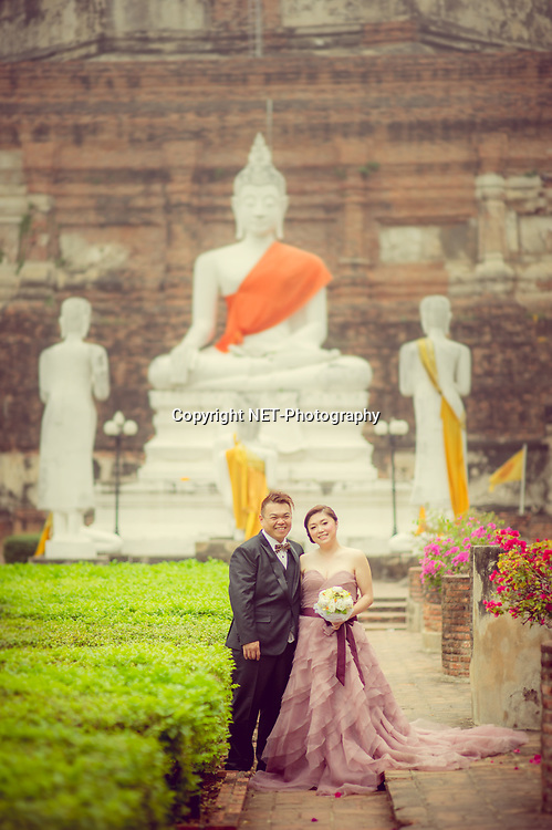 Ayutthaya Thailand - Yoko and Tor's prewedding (prenuptial, engagement session) at Wat Yai Chai Mongkhon in Ayutthaya, Thailand.<br /> <br /> Photo by NET-Photography<br /> Ayutthaya Thailand Wedding Photographer<br /> info@net-photography.com<br /> <br /> View this album on our website at http://thailand-wedding-photographer.com/pre-wedding-ayutthaya-mae-klong-market/?utm_source=photoshelter&amp;utm_medium=link&amp;utm_campaign=photoshelter_photo
