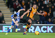 Hull City midfielder Jake Livermore (14) gets away from Brighton winger, Jamie Murphy (15) during the Sky Bet Championship match between Hull City and Brighton and Hove Albion at the KC Stadium, Kingston upon Hull, England on 16 February 2016.