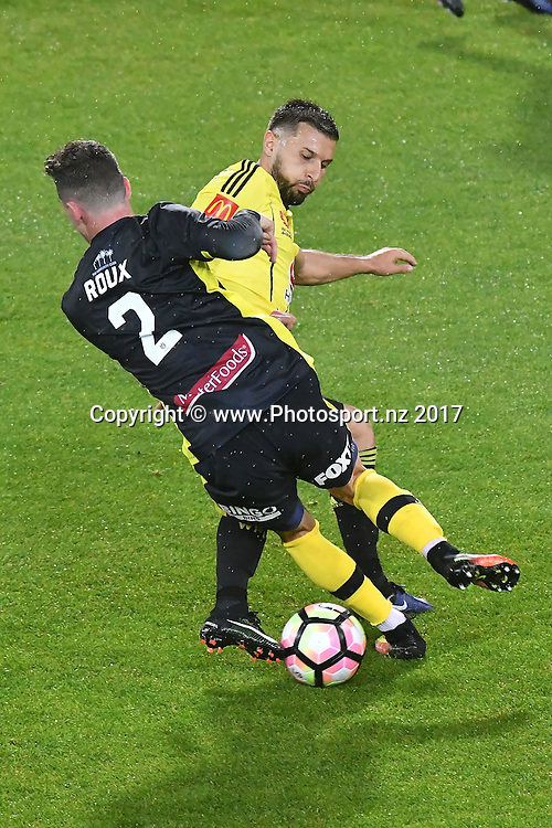 Phoenix's Kosta Barbarises (Back) fights for possession with Mariners' Storm Roux during the A-League - Phoenix v Central Coast Mariners football match at Westpac Stadium in Wellington on Saturday the 14 January 2017. Copyright Photo by Marty Melville / www.Photosport.nz