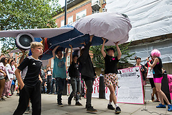 London, UK. 29 July, 2019. Activists from Reclaim the Power, All African Women's Group, Docs Not Cops, Lesbians and Gays Support the Migrants and other groups protest with a model of an aircraft used for deportation flights outside the Home Office to demand an end to the Government's 'hostile environment' policies.