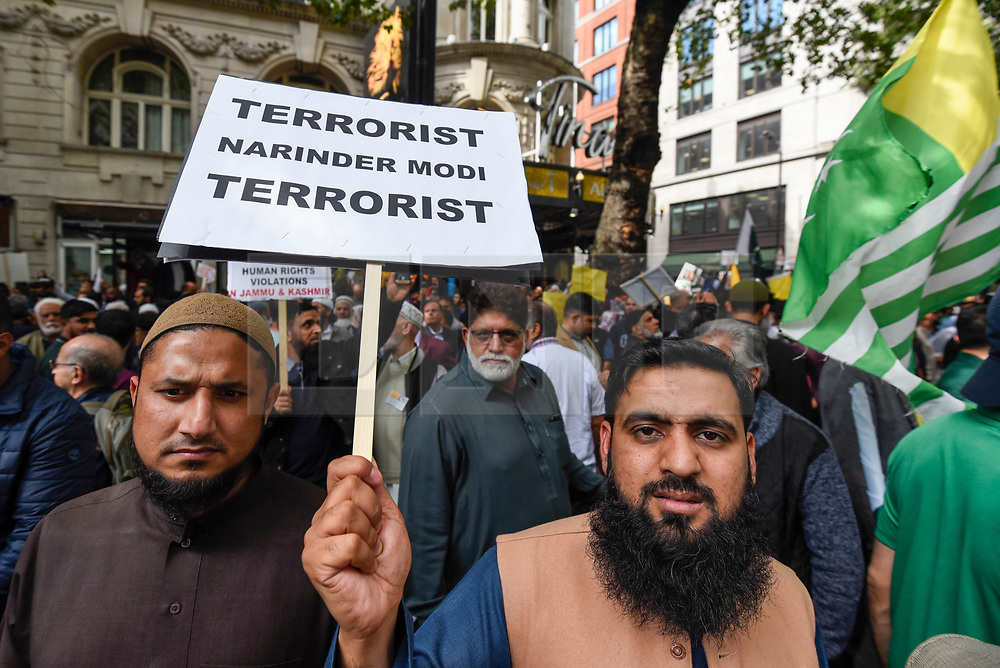 © Licensed to London News Pictures. 15/08/2019. LONDON, UK.  Men hold up a sign as thousands of protesters, many waving Pakistani and Kashmiri flags, gather outside the Indian High Commission in Aldwych, on what they are calling Black Day, to stand in solidarity with the people of Kashmir.  Indian Prime Minister Narendra Modi delivered an Independence Day speech highlighting his decision to remove the special rights of Kashmir as an autonomous region.  Photo credit: Stephen Chung/LNP