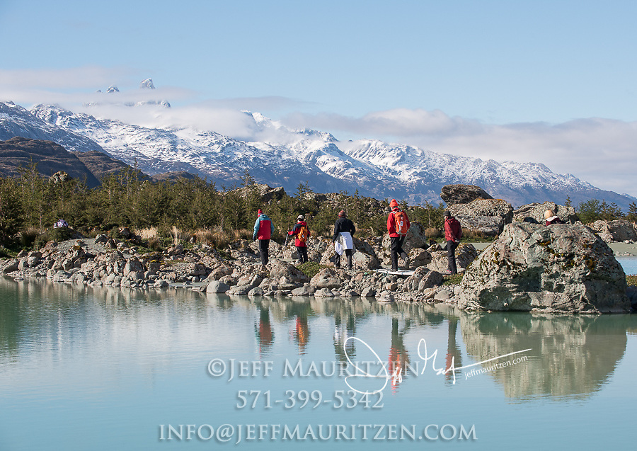 Hikers make their way through Estero las Montanas while visiting Bernal glacier (Benito glacier), Alacalufes National Reserve, Southern Chilean Fjords.