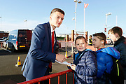 Middlesbrough defender Dael Fry (20)  signing autographs  during the EFL Sky Bet Championship match between Middlesbrough and Ipswich Town at the Riverside Stadium, Middlesbrough, England on 29 December 2018.