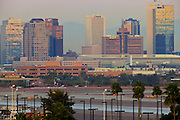 18 JANUARY 2011 - PHOENIX, AZ: As seen from the parking deck at Phoenix Sky Harbor Airport, the tall buildings east facing of downtown Phoenix reflect the sunrise over the city, Tuesday, Jan 18.  PHOTO BY JACK KURTZ