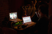 Dec. 6, 2013 - Brooklyn, NY. Crew members monitor the Audiofiles live show in the Jalopy Theatre. 12/6/13 Photograph by Julius C. Motal/CUNY Journalism PHOTO