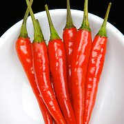 Pile of hot bright red chilli peppers in a bowl