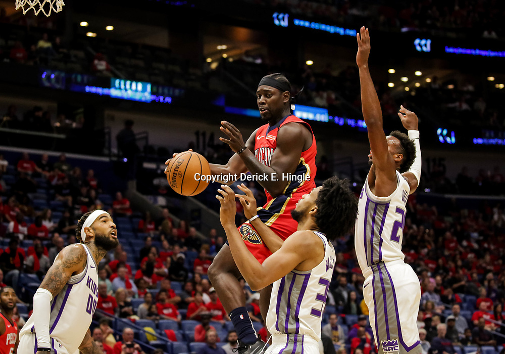 Oct 19, 2018; New Orleans, LA, USA; New Orleans Pelicans guard Jrue Holiday (11) passes as Sacramento Kings forward Marvin Bagley III (35) and guard Buddy Hield (24) defend during the first quarter at the Smoothie King Center. Mandatory Credit: Derick E. Hingle-USA TODAY Sports