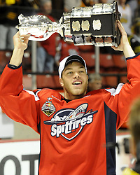 Taylor Hall of the Windsor Spitfires hoists the Memorial Cup after the championship game of the 2010 MasterCard Memorial Cup in Brandon, MB on Sunday May 23. Photo by Aaron Bell/CHL Images