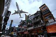 Kowloon. Landing low in Kai Tak Airport.