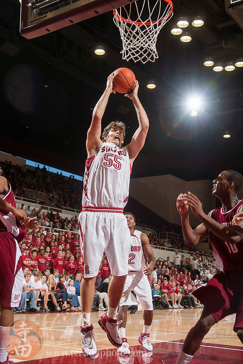 November 25, 2006; Stanford, CA, USA; Stanford Cardinal center Peter Prowitt (55) grabs a rebound during the game against the Denver Pioneers at Maples Pavilion. The Cardinal defeated the Pioneers 82-39.