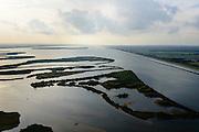 Nederland, Overijssel, Flevoland, 10-10-2014; Ketelmeer, onderdeel van de Randmeren Noord. Natuurgebied IJsselmonding. Onstaan door de inpoldering in 1956 van Oostelijk Flevoland.<br /> Border lake, was created by the reclamation of Eastern Flevoland in 1956.v<br /> Zwarte Meer met Ramsgeul, balgstuw bij Ramspol en Ketelmeer aan de horizon.<br /> Waterway next to one of the new polders.<br /> luchtfoto (toeslag op standard tarieven);<br /> aerial photo (additional fee required);<br /> copyright foto/photo Siebe Swart
