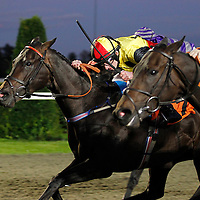 Ebony Roc and Ryan Moore winning the 7.15 race