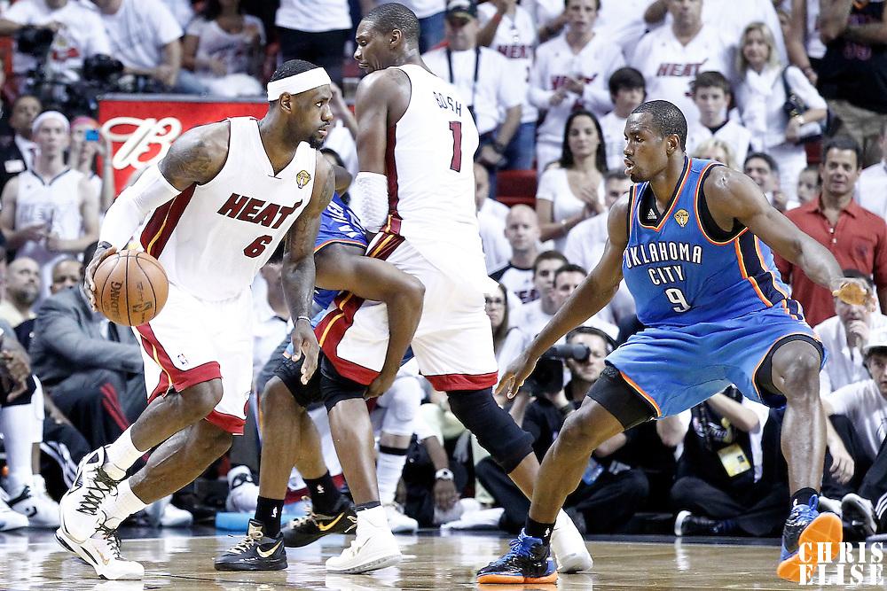 21 June 2012: Oklahoma City Thunder power forward Serge Ibaka (9) defends on Miami Heat small forward LeBron James (6) during the Miami Heat 121-106 victory over the Oklahoma City Thunder, in Game 5 of the 2012 NBA Finals, at the AmericanAirlinesArena, Miami, Florida, USA. The Miami Heat wins the series 4-1.