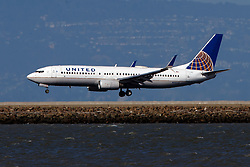 Boeing 737-824 (N14237) operated by United Airlines landing at San Francisco International Airport (KSFO), San Francisco, California, United States of America