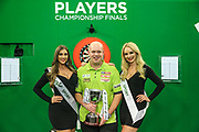 Michael van Gerwen receiving his winners trophy during the PDC Darts Players Championship at  at Butlins Minehead, Minehead, United Kingdom on 26 November 2017. Photo by Shane Healey.