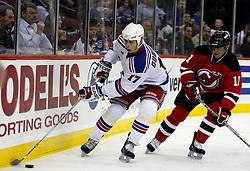 November 14, 2007; Newark, NJ, USA;  New York Rangers center Brandon Dubinsky (17) avoids the New Jersey Devils center John Madden (11) during the third period at the Prudential Center in Newark, NJ.